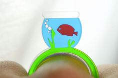 How cool is this ring from LicketyCut on Etsy! http://www.etsy.com/listing/64598101/fish-bowl-laser-cut-acrylic-ring-set