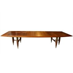 Eugenio Escudero Dining Table   From a unique collection of antique and modern dining room tables at https://www.1stdibs.com/furniture/tables/dining-room-tables/