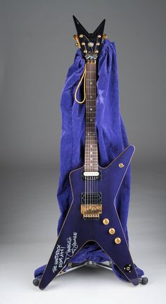"One of the most kick ass guitars in the Hard Rock collection, Dimebag Darrell's Washburn ""Crown Royal"", with the special bag made just for him by the liquor company. He even signed it for us with ""The Hard Rock Kicks Ass!"" He really was an incredible guy. #livefornow #hrtreasures"