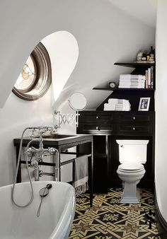 beautiful small bathroom. Special note to the flooring choice.  Summer Thornton Design
