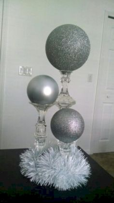 Discover thousands of images about DIY Dollar Tree candlesticks. 2 glued together for medium height, and 3 for the tallest. Place large ornaments on top, or paint Styrofoam spheres. Christmas Diy, Christmas Decorations, Wedding Decorations, Birthday Decorations, Silver Decorations, Winter Party Decorations, Dollar Tree Christmas, Ball Decorations, Christmas Centerpieces