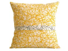 Cojin amarilllo y gris geométrico