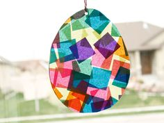 Suncatcher Easter Eggs are a great kids' craft idea. This project is easy enough for them to do with minimal supervision and can make a great gift idea. Keeping the kids busy creat