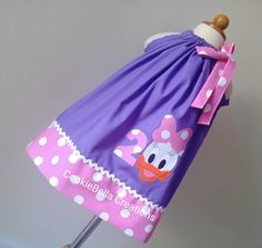 Daisy Duck Inspired Purple/Pink Polka Dot pillowcase dress. Perfect birthday party dress for baby toddler and little girls. Good for Disneyworld too!