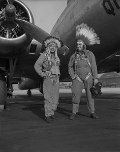 Gus Palmer (Kiowa, at left), side gunner, and Horace Poolaw (Kiowa), aerial photographer, in front of a B-17 Flying Fortress. MacDill Field, Tampa, Florida, ca. 1944 [2130x2700]