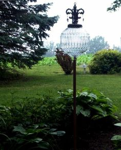 Carol Dial used lamp parts and a stake to make her garden accent