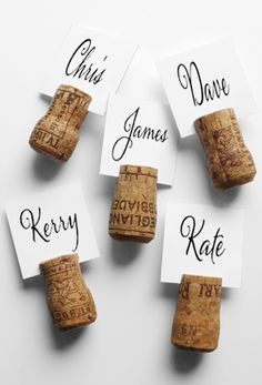 wine corks as  table number holders paint them gold or roll them in sparkles!!!!