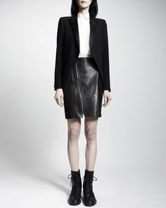 Saint Laurent Covered-Button-Down Blouse on shopstyle.com | Yves Saint Laurent first made the feminine tuxedo jacket and top famous in the early seventies. Now, decades later, the vampy leather skirt gives the look a grunge twist—keeping in line with Hedi Slimane's rocker theme for the Fall 2013 Saint Laurent collection. Details Leather Zip-Front Skirt: Leather. Offset asymmetric front zip with zip trim. Wide ribbed band at back waist. Hem falls mid-thigh. Lambskin; cupro/cotton. Made in…