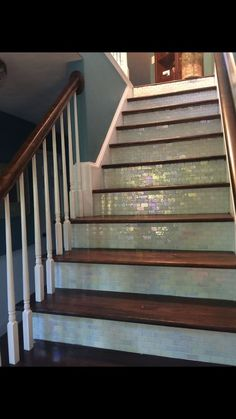 A homeowner updates her boring entryway stairs. First she removes the 'ugly' carpet, but then she does THIS!