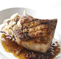 Grilled Pork Chop with Caramelized Onion Sauce