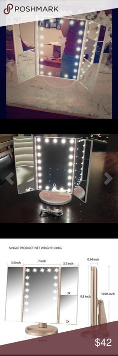 LED Trifold Vanity Mirror white The perfect touch to glamour your room and your makeup table up !  •Many customers have ordered and loved it !!----Check out my ratings.  •Touch screen for Dimmable lights  •Powerful LED lights for natural lights - no more over makeup or missing any spots while applying your makeup  •Operated by battery (4 AA ) not included - perfect for traveling  or USB cable ( included)  *FOLDABLE : protect the mirror while travel  •One panel of the mirror has 2x and 3x…