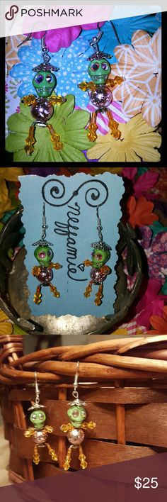 Dia de Los Muertos earrings Handcrafted with a funky twist,  these earrings are a fun conversation starter!! The Reconstituted stone skulls have Swarovski embellishments.  The bodies are constructed with wire, acrylic and glass beads with  metal hats!  Also, these little guys are very lightweight!! Sneffamie  Jewelry Earrings