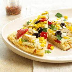A ricotta and Parmesan cheese spread replaces the usual tomato-based sauce in this easy Chicken and Corn Pizza recipe. (It's ready in less than 30 minutes!)