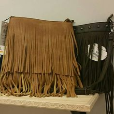 Cool and hot style with a touch of BoHo, the fringe crossbody bag is sassy and will make a strong impression with any style you put together. www.filettas.com #bohobag #crossbodybag #fringbag #bags #localboutique