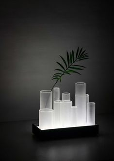 FROST - 2016 - Wood, plexiglass, Leds - This tray-like table lamp uses frosted tubes that catch the light emitted from the base and spread it all around. -
