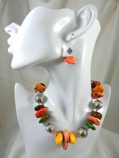 This necklace is made with large  flat chunks of green, orange, yellow, coral, and brown turquoise.  These measure from 34mm, which is about 1 1/4 inches to 14mm which is just over 5/8 inches.  These