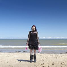 This goth enjoying a day at the seaside.