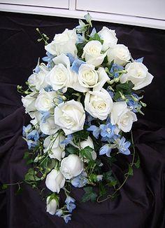 White Roses and Blue Sweet Peas beautiful!