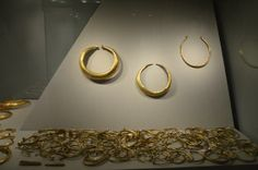 National Museum of Ireland - Archaeology: gold gold gold.  there is some thought that the  Irish  did not wear  gold in their ears.  that leaves  putting these rings in their  hair, or  on  bands on their heads.