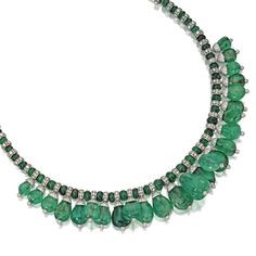 Platinum, Emerald Bead and Diamond Necklace Supporting a fringe of emerald bead pendants, supported by a necklace composed of emerald beads, total weight of emeralds approximately 665.00 carats, accented by round diamonds weighing approximately 43.00 carats, length 15¼ inches.