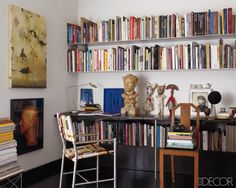 Bookcase Styling Ideas We Stole From the Pros : Try neat rows of vertical books for an orderly but stylish home office.  Source: Elle Decor