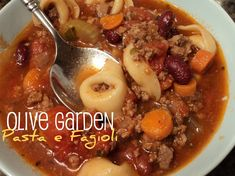 Olive Garden Crock Pot Pasta e Fagioli    2 lb ground beef  1 onion, chopped  3 carrots, chopped  4 stalks celery, chopped  2 (28 oz) diced tomatoes, undrained  1 (16 oz) red kidney beans, drained  1 (16 oz) white kidney beans, drained  3 (10 oz) beef stock  3 tsp oregano  2 tsp pepper  5 tsp parsley  1 tsp Tabasco sauce  1 (20 oz) jar spaghetti sauce  8 oz frozen cheese tortellini