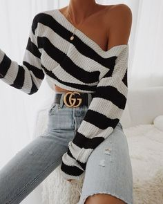 ripped high rise jeans with a black and white sweater and black gucci belt. Visit Daily Dress Me at dailydressme.com for more inspiration women's fashion 2018, fall fashion, winter fashion, casual outfits, school fashion, women' blouses, sweaters, high rise pants, high waisted jeans, gucci, designer, accessories, belts