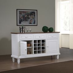 Complete your living space with this elegant wooden country buffet table. This buffet features two wooden doors, three drawers, and 12 wine cubbies for maximum storage space, and a sleek white finish to match traditional or contemporary decor.