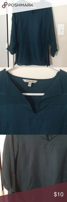 Turquoise tunic from Calvin Klein jeans Worn once, great condition. Mid thigh length. Calvin Klein Tops Tunics