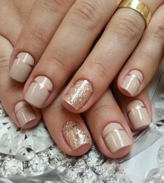 Nude and gold polish combination. What better way than to combine striking gold with the subtle colored nude polish? They look perfect with each other.