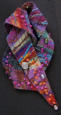 Brooch - needle-felted, but could do similar with quilting and embroidery.