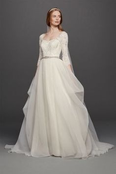 Rustic Wedding This elegant wedding dress with sleeves from Oleg Cassini  combines a classic organza skirt with a flattering sweetheart neckline and  ... d770237514a6