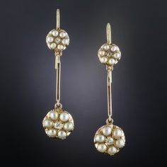 Just over 1 1/2 inch long and lovely (they drop a bit further from the new ear wires), a pair of pearl-petaled diamond-centered flowers are separated by slender rose gold bars. The bars easily slip off so that the tops may be worn alone. Circa mid-19th century Great Britain.