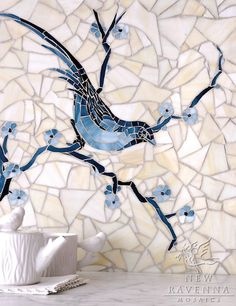 Materials & Sources features the Fall 2013 Look Book from New Ravenna Mosaics - Chinoiserie, a hand cut jewel glass mosaic shown in Marcasite, Pewter and Mica with a Quartz Sea Glass background, is part of the Delft Collection by Sara Baldwin for New Ravenna Mosaics.