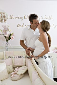 Maternity photos in the nursery. I so want to do this!