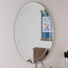 $96 Decor Wonderland 23.6-in W x 31.5-in H Oval Frameless Bathroom Mirror with Hardware and Beveled Edges