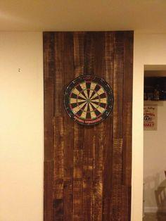 Good idea for basement... wood behind dart board