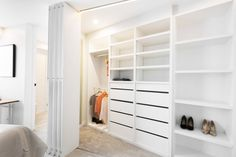 One judge called this wardrobe too big but we're saying there's no such thing! Bifolding wardrobe doors open up this spacious wardrobe in Dean and Shay's guest bedroom on The Block 2015. Great shoe storage, drawer storage and open shelving. See loads more photos from this winning room on our blog!