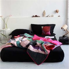The Rangoli patchwork bedspread, handcrafted from silk in India.