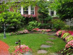 Because this garden gets lots of annual rainfall, colorful impatience are planted generously in this more open area of the garden. Rain Garden Design, Rain Photo, Outdoor Spaces, Outdoor Decor, Backyard, Patio, Garden Borders, Garden Photos, Garden Inspiration