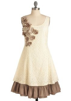 Modcloth Vanilla Biscotti Dress  With a sprinkling of creme- and taupe-hued flowers across the shoulder, and satiny ruffles peeking out from beneath the hem, this darling dress will be your go-to frock for all occasions. Paired with patterned tights, gold heels, and a cappuccino-hued clutch, you'll look as sweet as you feel.