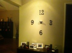 Homemade wall clock made of crafted numbers and a recycled clock motor. New home, fun ideas!  (Home of Jake Austin)