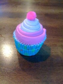 Washcloth cupcakes. These are smaller than the receiving blanket cupcakes, so you have to make a lot to make it look right.