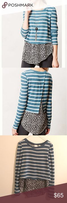 """Anthropologie Layered Ginny Pullover Anthropologie Layered Ginny Pullover in blue. Striped pullover with buttondown shirt hem. Hem area has 3 buttons, and is of black and white floral print. Material is made of polyester, rayon, spandex. 28""""L. Sweater material has slight signs of wear but otherwise in a very good condition. Anthropologie Tops"""