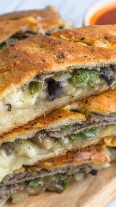 Philly Cheese Steak Stromboli, easy to make and it was extremely delicious!rib eye thinly sliced, in my opinion is the best cut of meat for any type of cheese steak. Pizza Recipes, Beef Recipes, Cooking Recipes, Sandwich Recipes, Vegan Recipes, Recipies, Philly Cheese Steak Stromboli Recipe, Empanadas, Tapas