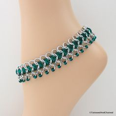 Chainmail anklet, emerald green ankle chain for women, glass chainmaille jewelry by TattooedAndChained on Etsy https://www.etsy.com/listing/219489450/chainmail-anklet-emerald-green-ankle