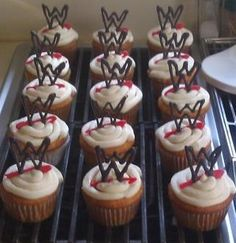 My WWE inspired cupcakes! Just normal cupcakes with cream cheese frosting. I melted candy melts then piped it on to wax paper into the WWE logo. Left to dry then placed on top of the cupcakes!