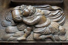 A monk takes a drink (with some enthusiam): 16th C. misericord, the Collegiate Church of Notre-Dame (Collégiale Notre-Dame), Le Puy-Notre-Dame, Anjou, France | Flickr - Photo Sharing!