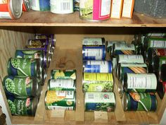 "Here is how I solved the endless ""what can will I grab"" from the food pantry. I cut strips of wood then placed in rows to hold my canned goods on the bottom shelf of my cabinet."