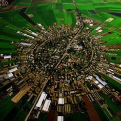 Nahalal, Palestine  Concentric layout in where the city buildings are in the center, then houses and then farmland. Beautiful idea.  The downside is that there is no room for growth.